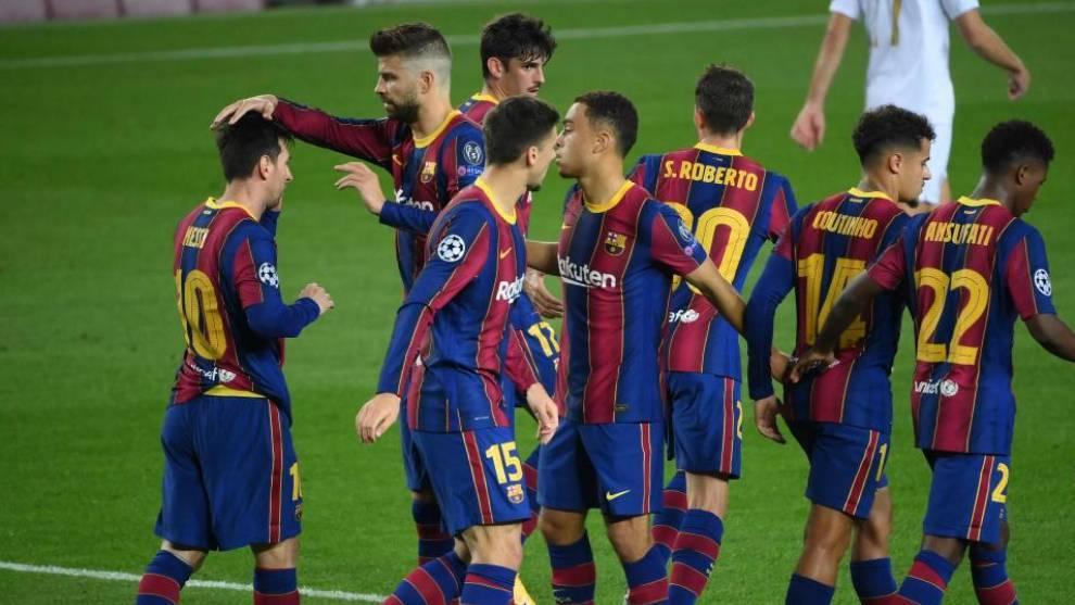 Barcelona's Argentine forward Lionel Messi celebrates with teammates.