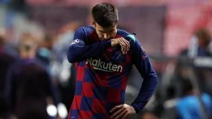 Piqué, abatido tras caer 2-8 ante el Bayern la temporada pasada