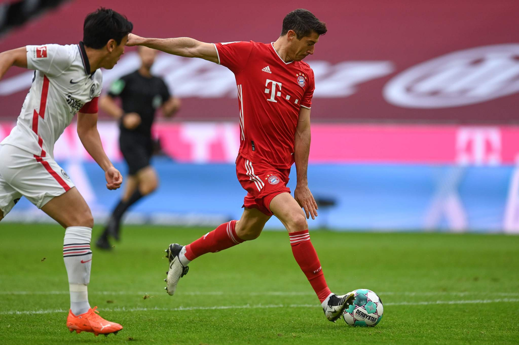 Bayern Munichs Polish forward Robert lt;HIT gt;Lewandowski lt;/HIT gt; scores the opening goal during the German first division Bundesliga football match between FC Bayern Munich and Eintracht Frankfurt on October 24, 2020 in Munich, southern Germany. (Photo by CHRISTOF STACHE / various sources / AFP) / DFL REGULATIONS PROHIBIT ANY USE OF PHOTOGRAPHS AS IMAGE SEQUENCES AND/OR QUASI-VIDEO