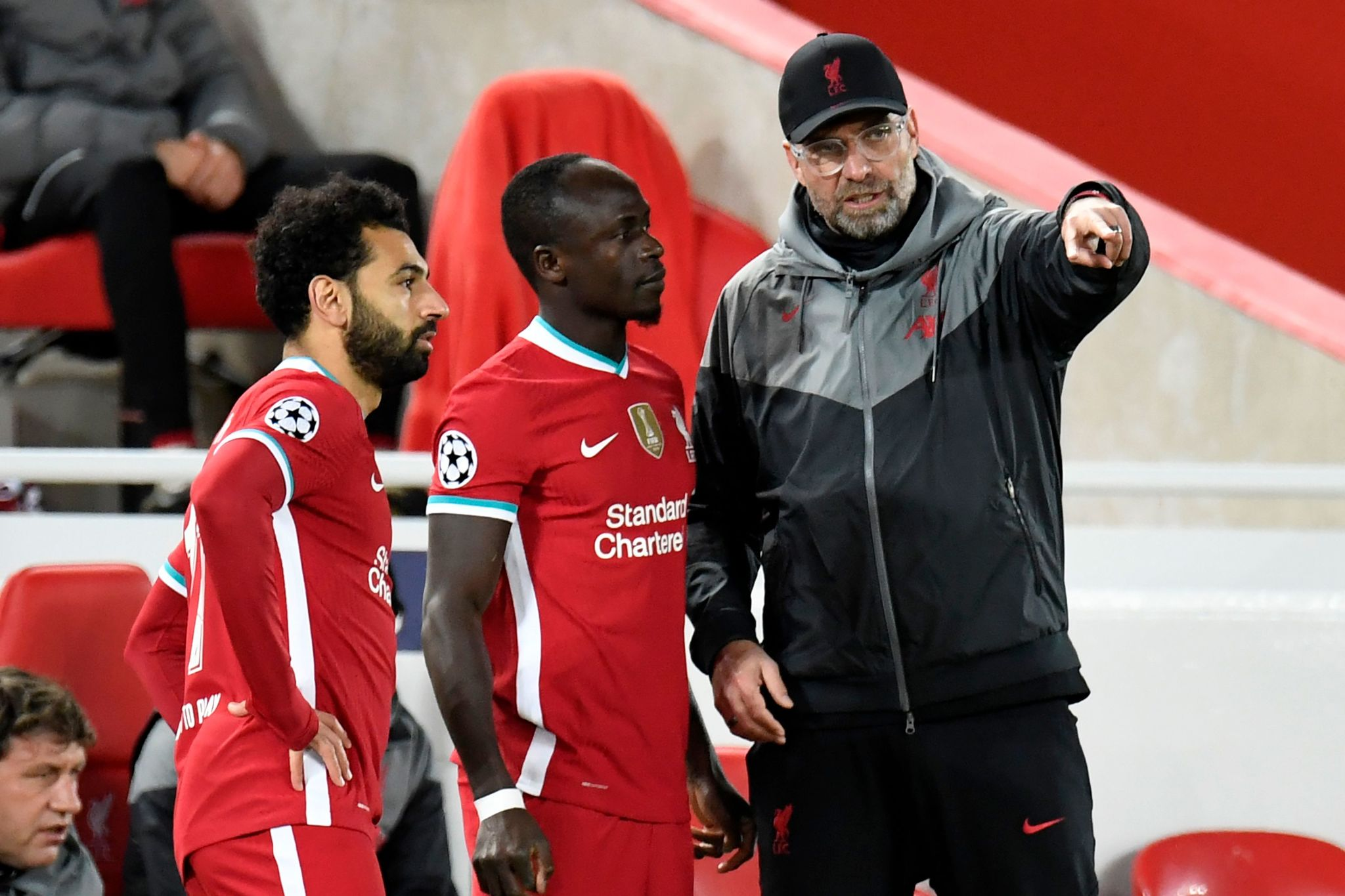 Liverpools German manager Jurgen lt;HIT gt;Klopp lt;/HIT gt; (R) speaks with Liverpools Senegalese striker Sadio Mane (C) and Liverpools Egyptian midfielder Mohamed Salah (L) as they prepare to come on as substitutes during the UEFA Champions league Group D football match between Liverpool and Midtjylland at Anfield in Liverpool, north west England on October 27, 2020. (Photo by PETER POWELL / POOL / AFP)