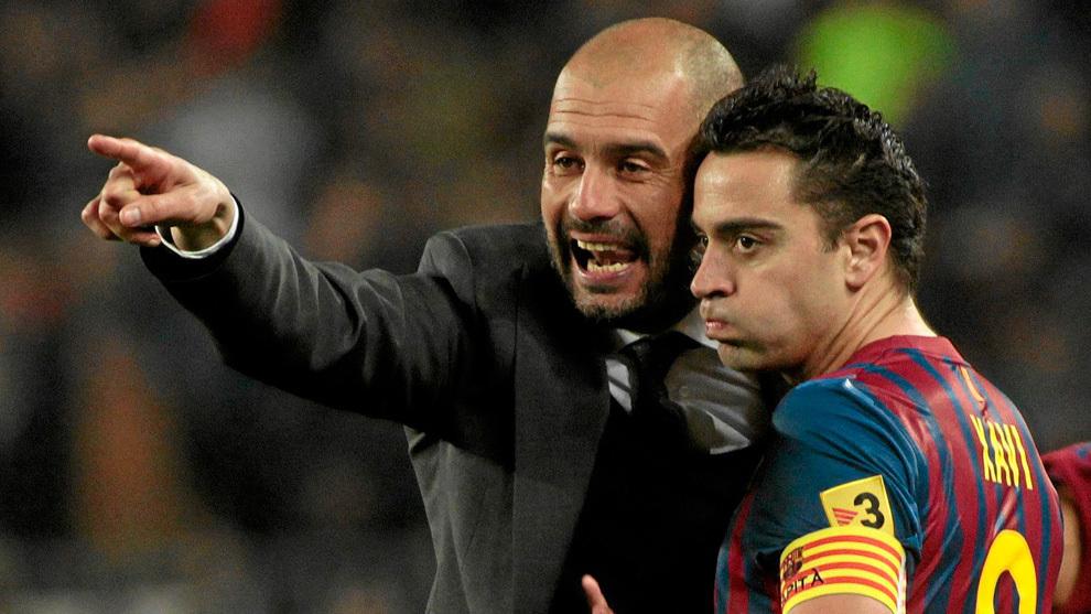 Pep Guardiola and Xavi Hernandez.