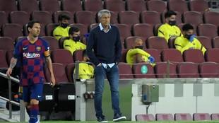 Setién y Messi, durante un partido.