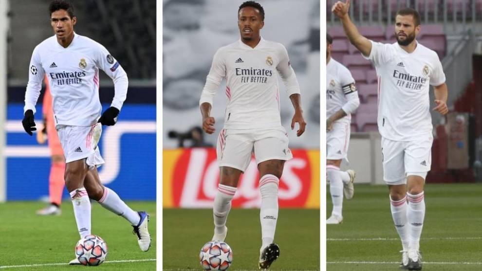 Varane, Militao y Nacho con la camiseta del Real Madrid.