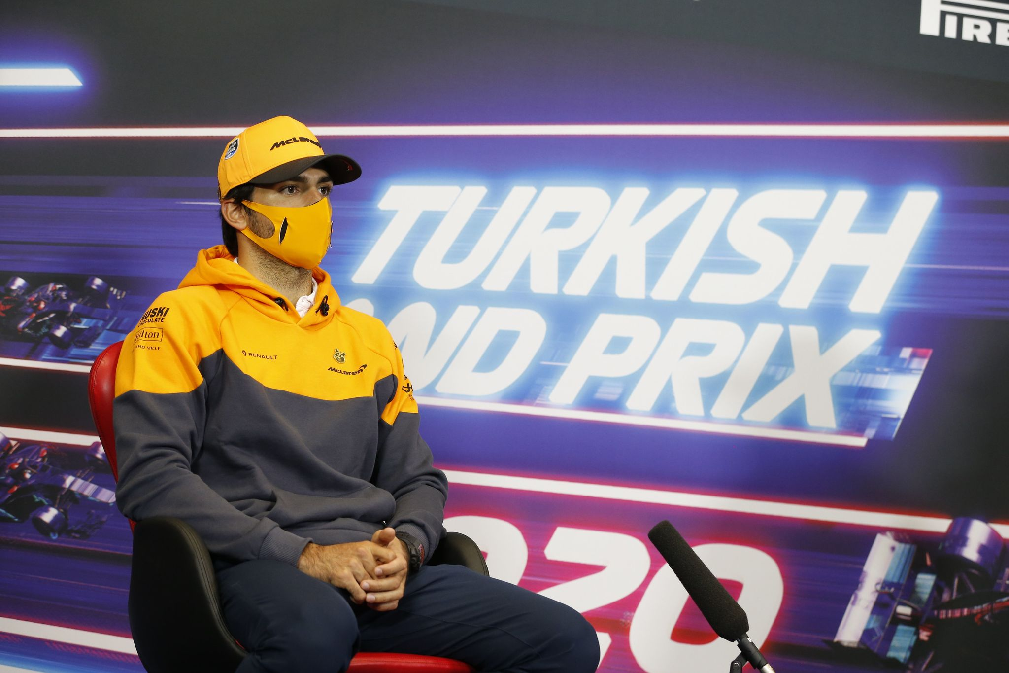 """This handout photo taken and released by FIA on November 12, 2020, shows McLaren's Spanish driver Carlos lt;HIT gt;Sainz lt;/HIT gt; Jr giving a press conference ahead of the Formula One Turkish Grand Prix at the Intercity Istanbul Park in Tuzla, near Istanbul. - The Formula One Turkish Grand Prix is held on November 15, 2020, at Intercity Istanbul Park. (Photo by Antonin Vincent / FIA / AFP) / RESTRICTED TO EDITORIAL USE - MANDATORY CREDIT """"AFP PHOTO / FIA / ANTONIN VINCENT- NO MARKETING NO ADVERTISING CAMPAIGNS - DISTRIBUTED AS A SERVICE TO CLIENTS"""