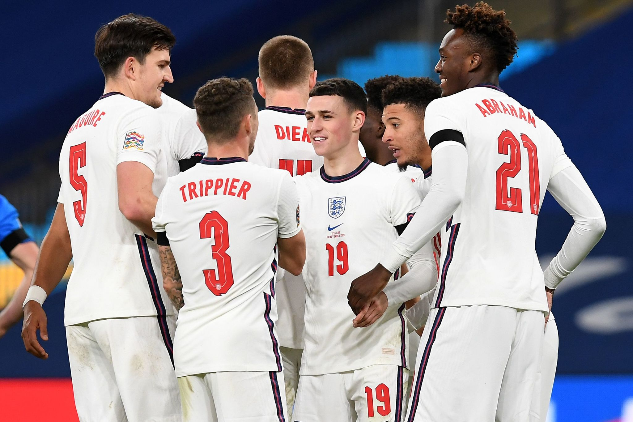 Englandss midfielder Phil lt;HIT gt;Foden lt;/HIT gt; (C) celebrates with team mates after scoring his teams third goal during the UEFA Nations League group A2 football match between England and Iceland at Wembley stadium in north London on November 18, 2020. (Photo by NEIL HALL / POOL / AFP) / NOT FOR MARKETING OR ADVERTISING USE / RESTRICTED TO EDITORIAL USE