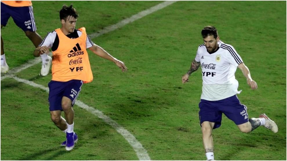 Nicolas Tagliafico and Leo Messi.
