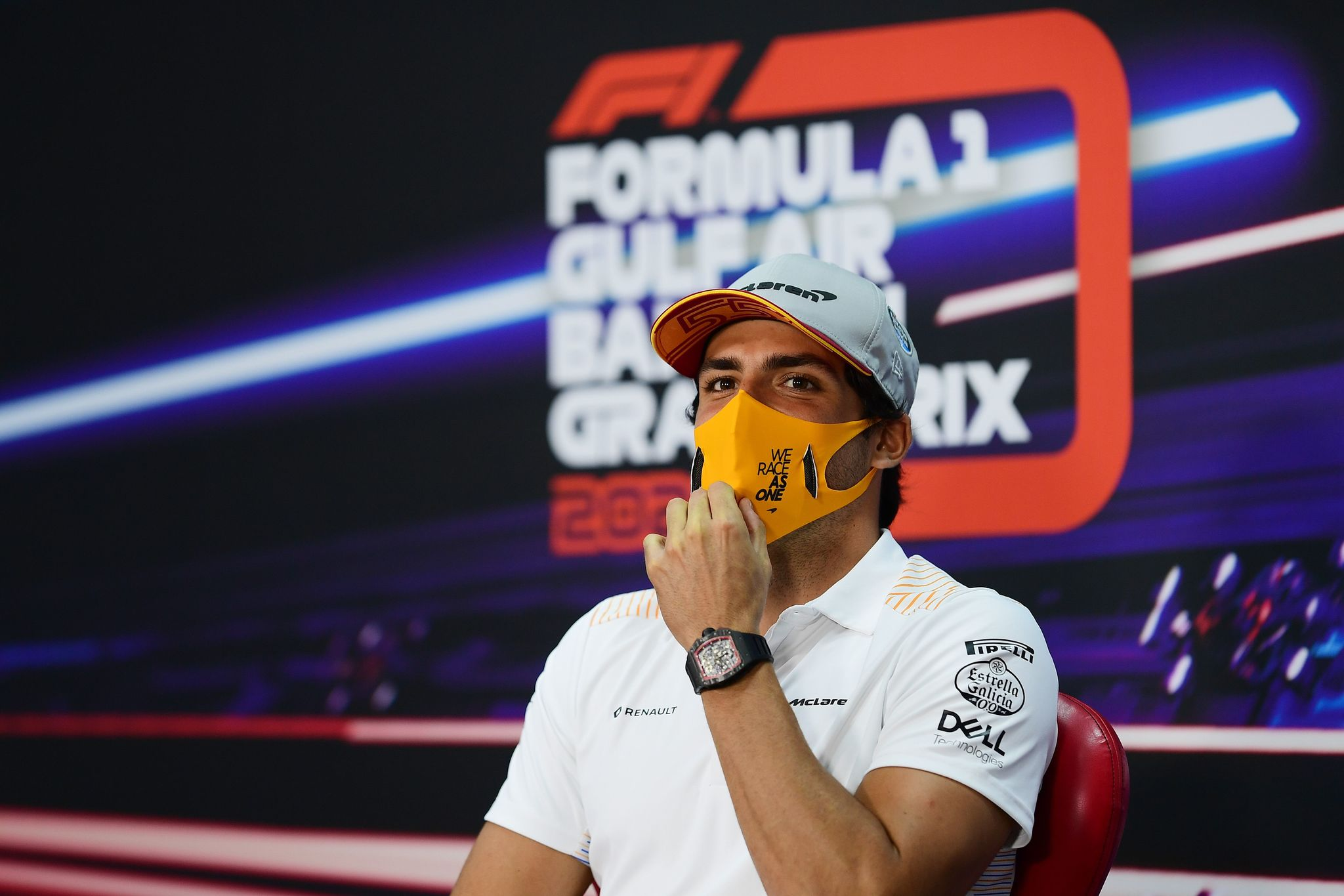 """McLarens Spanish driver lt;HIT gt;Carlos lt;/HIT gt; lt;HIT gt;Sainz lt;/HIT gt; Jr adjusts his mask during the presser ahead of the Bahrain Formula One Grand Prix at the Bahrain International Circuit in the city of Sakhir on November 26, 2020. (Photo by Mario RENZI / FIA / AFP) / RESTRICTED TO EDITORIAL USE - MANDATORY CREDIT """"AFP PHOTO / FIA / MARIO RENZI- NO MARKETING NO ADVERTISING CAMPAIGNS - DISTRIBUTED AS A SERVICE TO CLIENTS"""