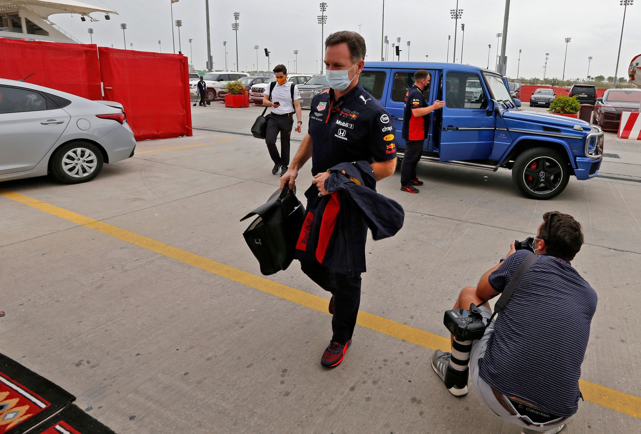 Red Bull Racing's Team Principal Christian lt;HIT gt;Horner lt;/HIT gt; (C) arrives for the first practice session ahead of the Bahrain Formula One Grand Prix at the Bahrain International Circuit in the city of Sakhir on November 27, 2020. (Photo by HAMAD I MOHAMMED / POOL / AFP)