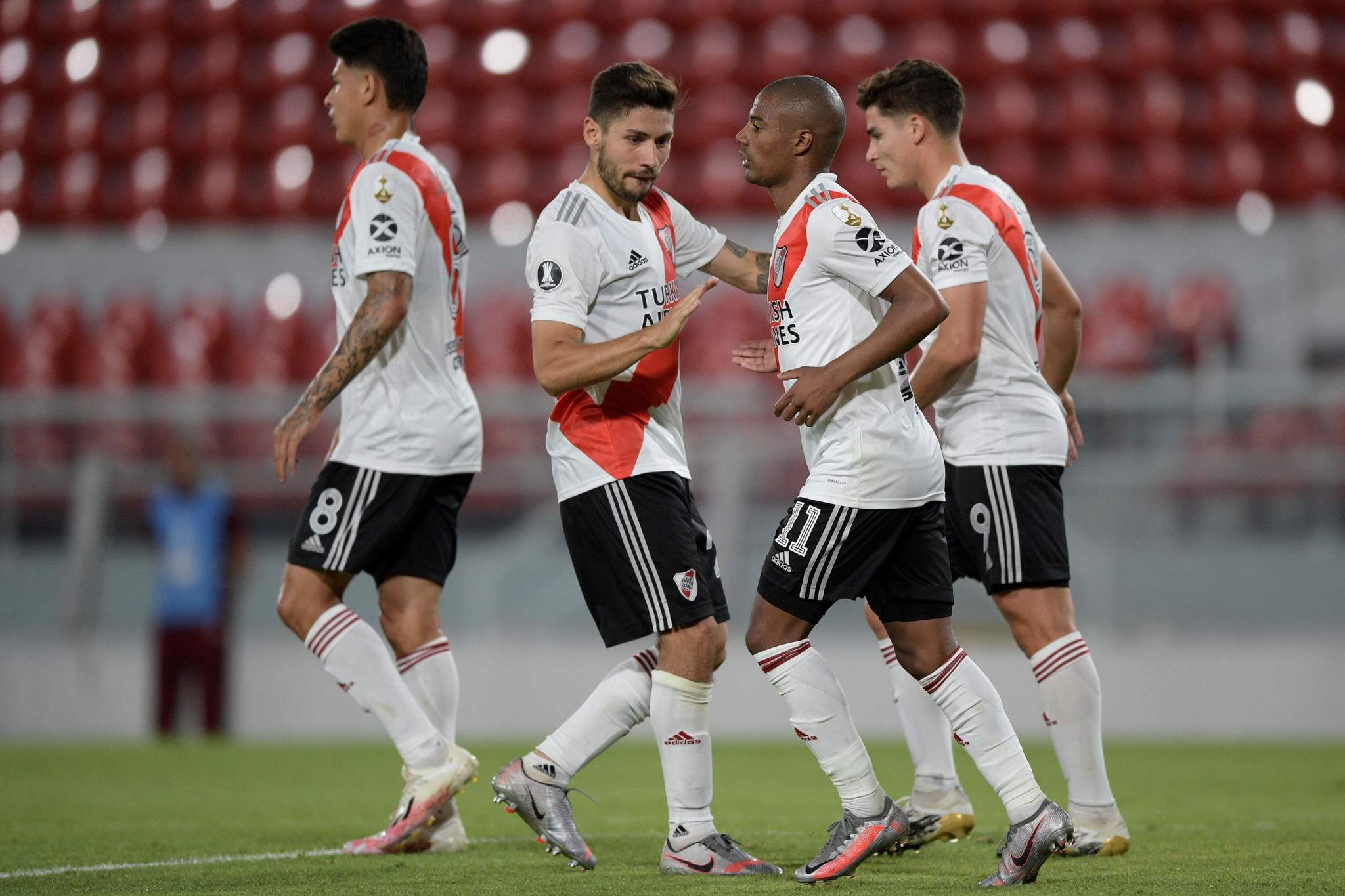 Argentinas lt;HIT gt;River lt;/HIT gt; lt;HIT gt;Plate lt;/HIT gt; Uruguayan Nicolas De La Cruz (2nd R) celebrates with teammates after scoring against Brazils Athletico Paranaense during the closed-door Copa Libertadores round before the quarterfinals football match, at the Libertadores de America stadium in Avellaneda, Buenos Aires, on December 1, 2020. (Photo by Juan Mabromata / POOL / AFP)