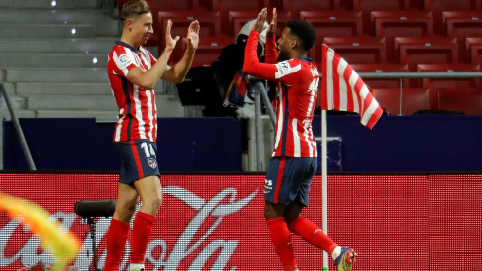 Lemar and Llorente take Atletico Madrid to the top of the table