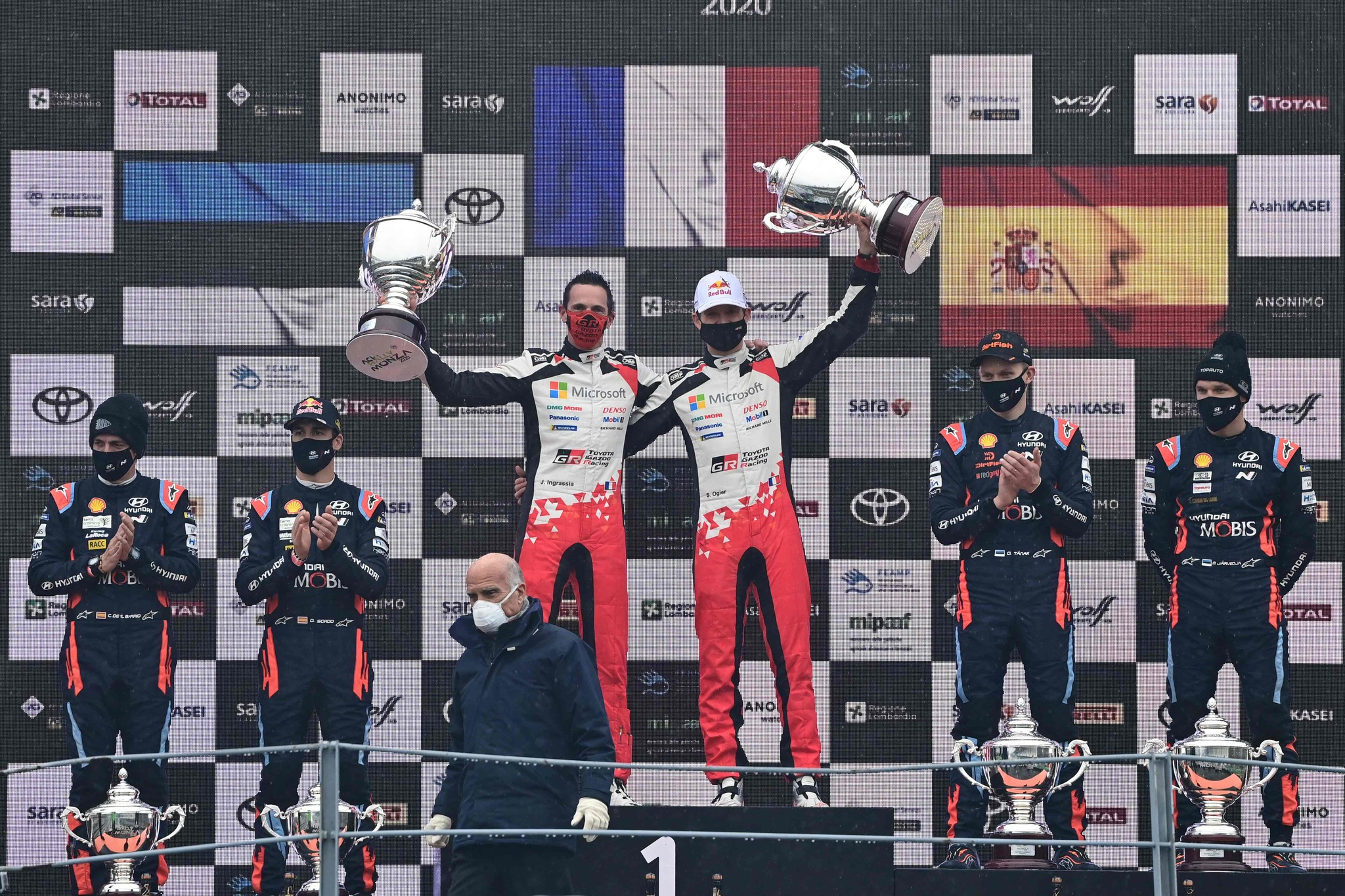 Winners French driver Sebastien lt;HIT gt;Ogier lt;/HIT gt; and his co-driver Julien Ingrassia (C), second-placed Estonian driver Ott Tanak and co-driver Martin Jarveoja and third-placed Spanish driver Dani Sordo and co-driver Carlos Del Barrio (R) celebrate on the podium after the FIA World Rally Championship at the Autodromo Nazionale circuit in Monza on December 6, 2020. (Photo by MIGUEL MEDINA / AFP)