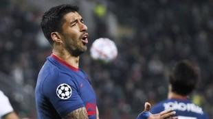Suárez lamenta una ocasión con el Atlético en Champions.