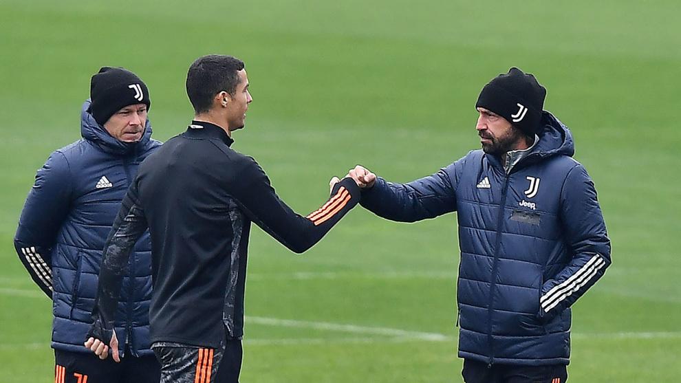 Pirlo greets Ronaldo at training.