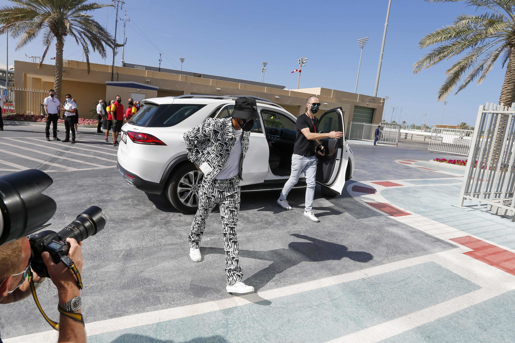 Mercedes British driver lt;HIT gt;Lewis lt;/HIT gt; lt;HIT gt;Hamilton lt;/HIT gt; arrives for the first practice session ahead of the Abu Dhabi Formula One Grand Prix at the Yas Marina Circuit in the Emirati city of Abu Dhabi on December 11, 2020. (Photo by HAMAD I MOHAMMED / POOL / AFP)