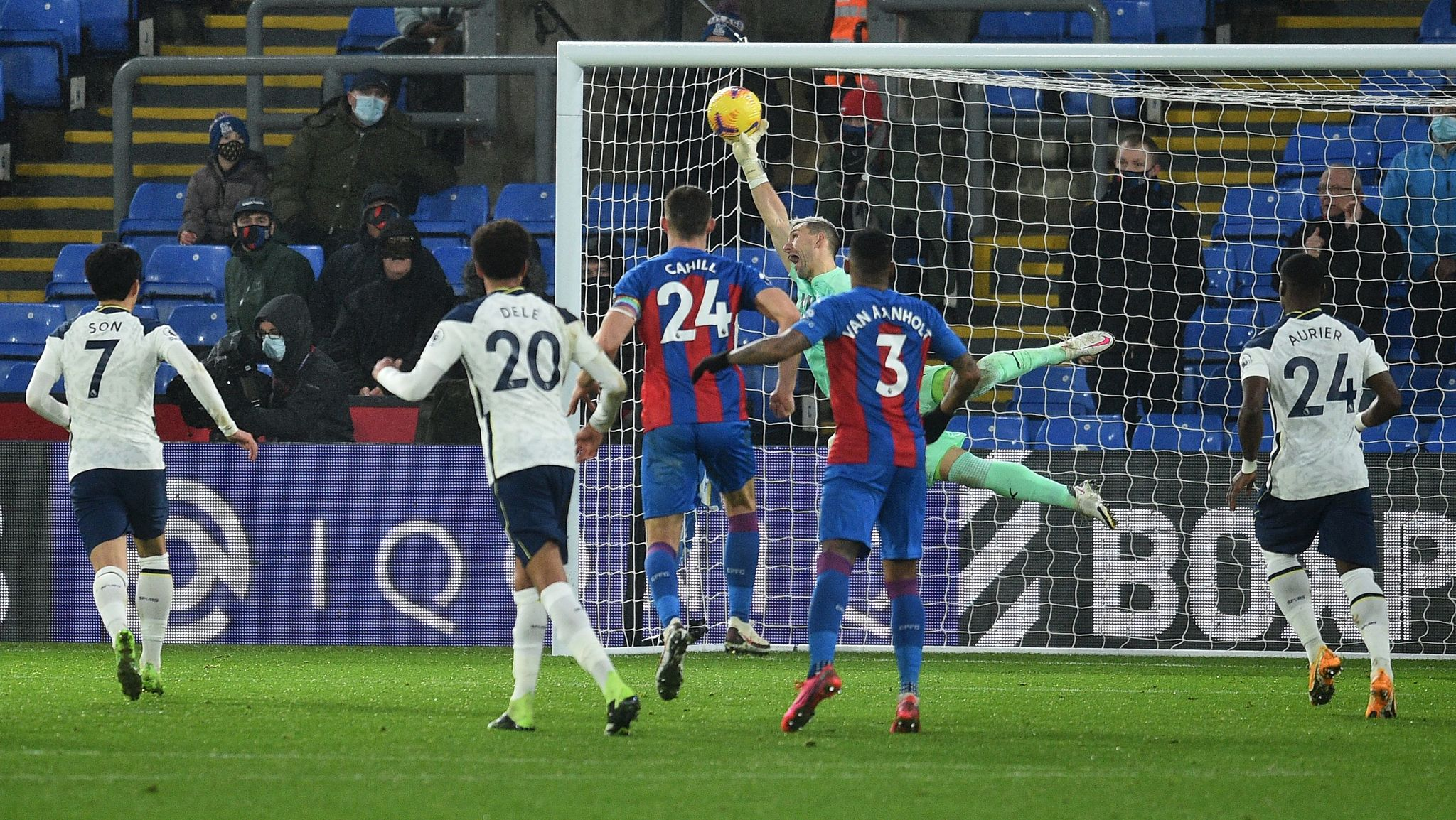 Crystal Palaces Spanish goalkeeper Vicente Guaita (back) tips the ball over the bar to make a save from a free kick by lt;HIT gt;Tottenham lt;/HIT gt; Hotspurs English defender Eric Dier during the English Premier League football match between Crystal Palace and lt;HIT gt;Tottenham lt;/HIT gt; Hotspur at Selhurst Park in south London on December 13, 2020. - The game ended 1-1. (Photo by Glyn KIRK / POOL / AFP) / RESTRICTED TO EDITORIAL USE. No use with unauthorized audio, video, data, fixture lists, club/league logos or live services. Online in-match use limited to 120 images. An additional 40 images may be used in extra time. No video emulation. Social media in-match use limited to 120 images. An additional 40 images may be used in extra time. No use in betting publications, games or single club/league/player publications. /