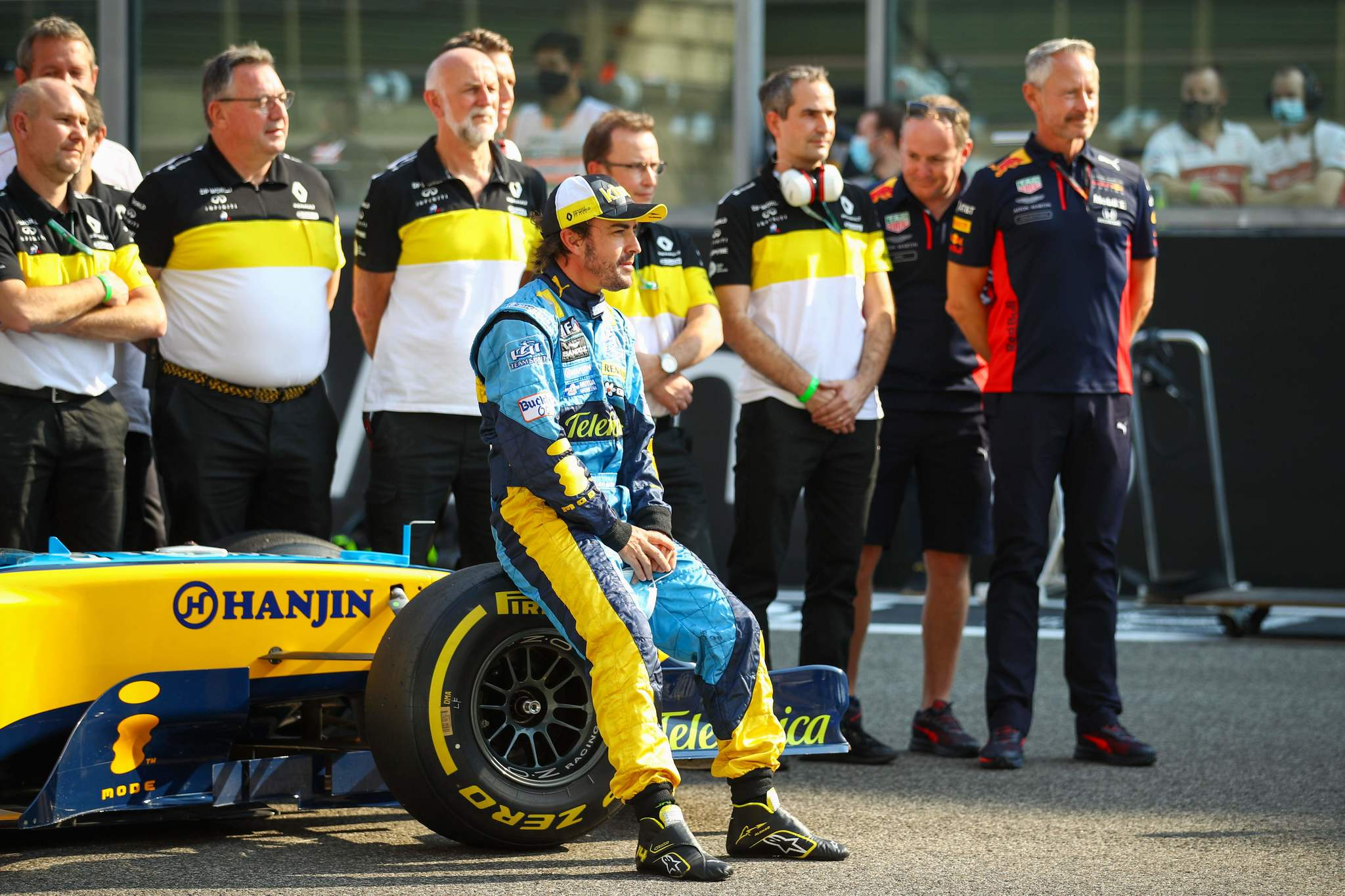 Renaults Spanish driver lt;HIT gt;Fernando lt;/HIT gt; lt;HIT gt;Alonso lt;/HIT gt; sits on the wheel of his Renault R25 car ahead of his demonstration laps prior to the Abu Dhabi Formula One Grand Prix at the Yas Marina Circuit in the Emirati city of Abu Dhabi on December 13, 2020. (Photo by Bryn Lennon / POOL / AFP)
