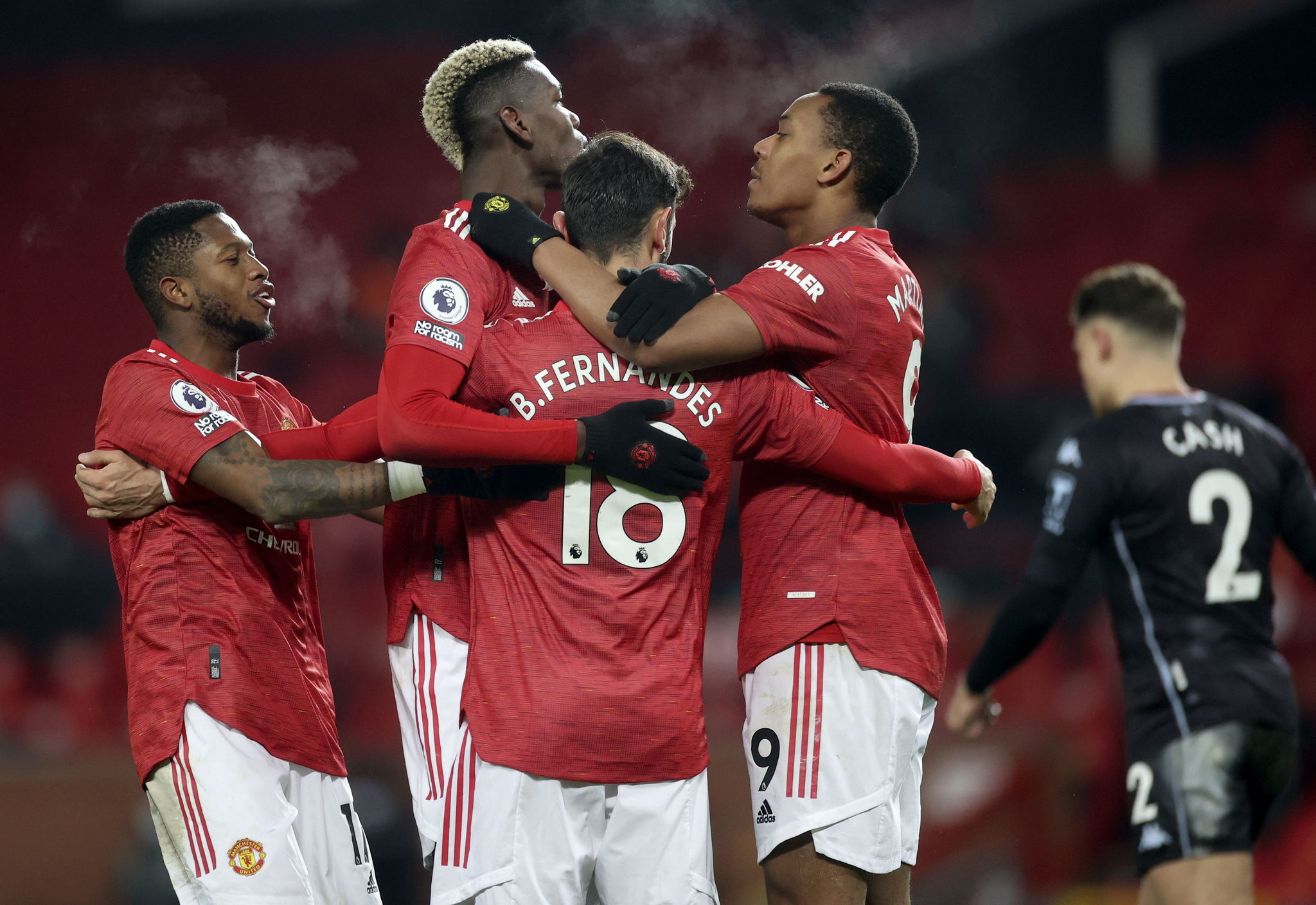 lt;HIT gt;Manchester lt;/HIT gt; ( lt;HIT gt;United lt;/HIT gt; Kingdom), 01/01/2021.- Bruno Fernandes (C) of lt;HIT gt;Manchester lt;/HIT gt; lt;HIT gt;United lt;/HIT gt; celebrates with teammates after scoring the 2-1 lead during the English Premier League soccer match between lt;HIT gt;Manchester lt;/HIT gt; lt;HIT gt;United lt;/HIT gt; and Aston Villa in lt;HIT gt;Manchester lt;/HIT gt;, Britain, 01 January 2021. (Reino Unido) EFE/EPA/Carl Recine / POOL EDITORIAL USE ONLY. No use with unauthorized audio, video, data, fixture lists, club/league logos or 'live' services. Online in-match use limited to 120 images, no video emulation. No use in betting, games or single club/league/player publications