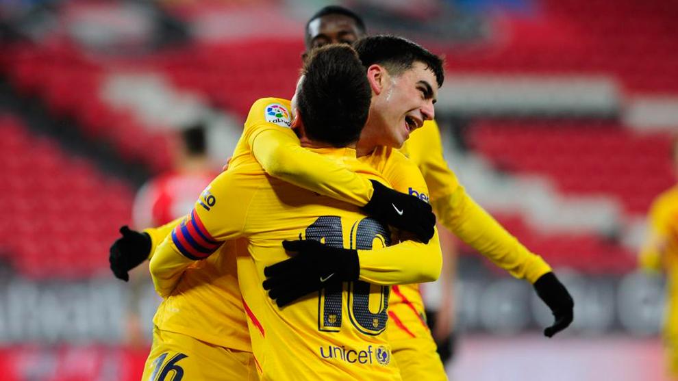 Pedri hugs Messi