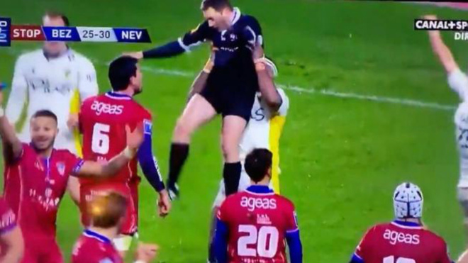 Rugby player celebrates win by lifting referee in the air