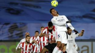 Varane jumps for the ball