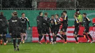 Kiel players in raptures after win.