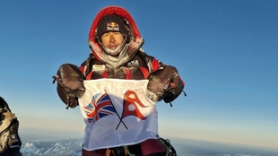 Nirmal Purja, en la cima del K2.