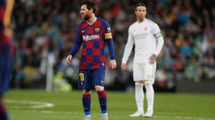 Leo Messi y el jugador del Real Madrid Sergio Ramos.