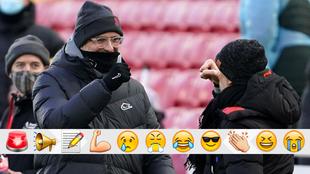 klopp y Guardiola se saludan al inicio del partido