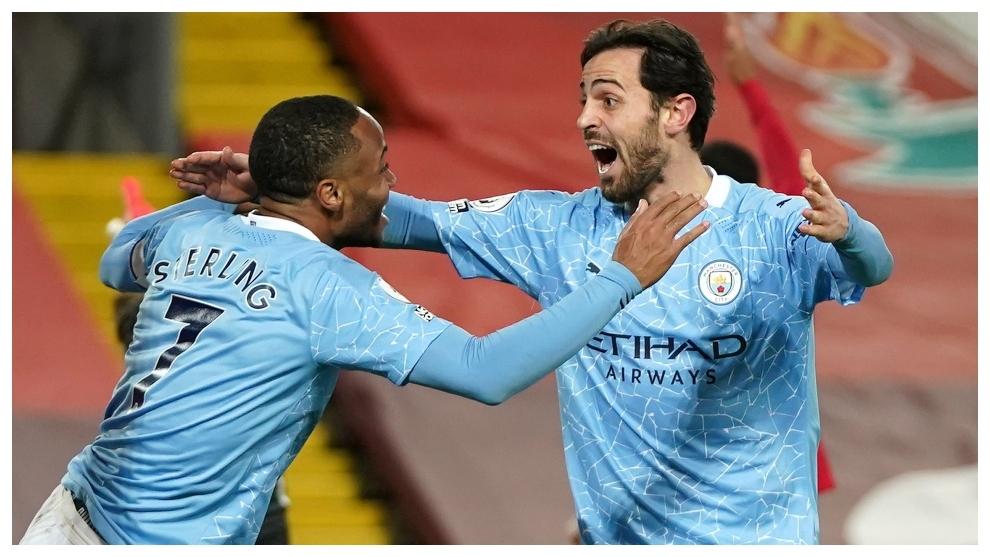 Raheem Sterling and Bernardo Silva celebrate a goal against Liverpool.