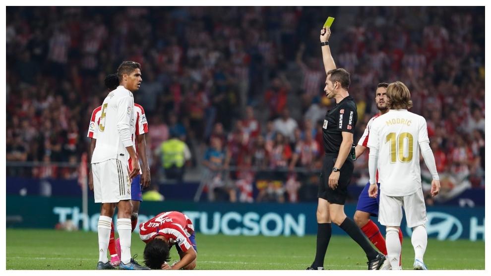 Varane being shown a rare yellow card