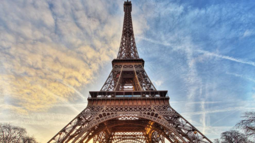 Eiffel Tower decked out in gold for Paris 2024 Olympics