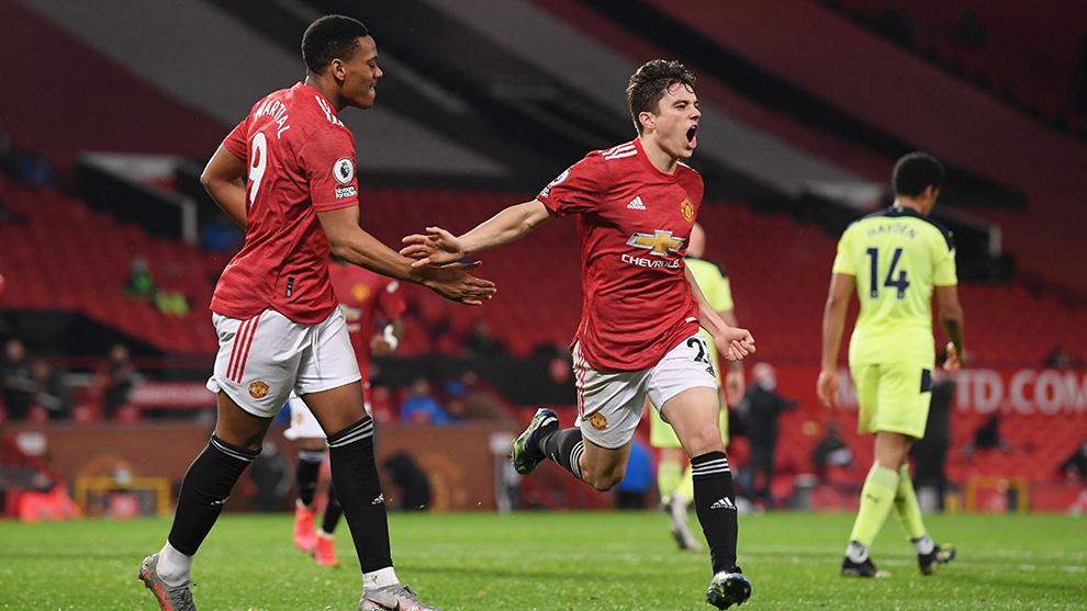Jugadores del United celebran.
