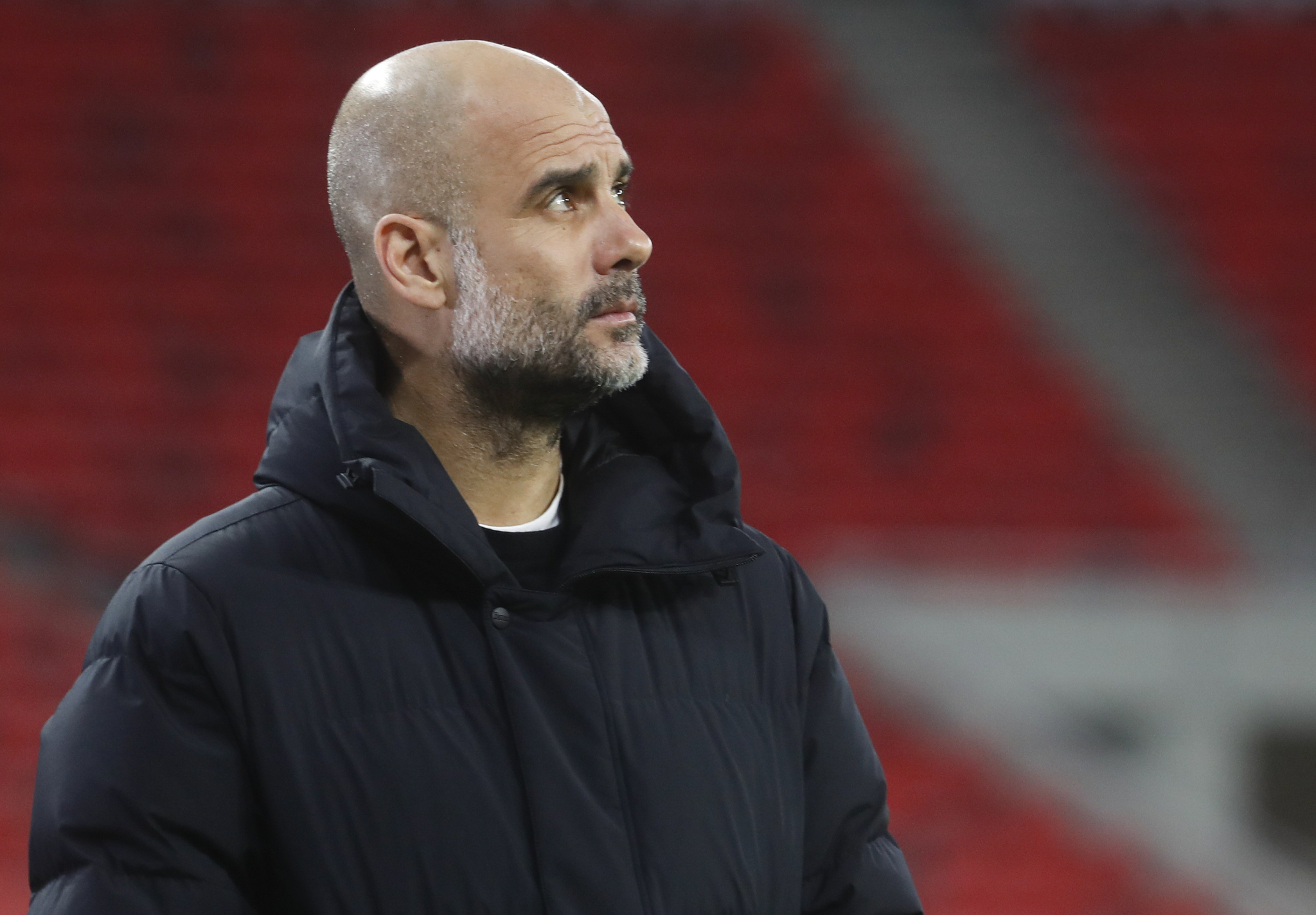Manchester City's head coach Pep lt;HIT gt;Guardiola lt;/HIT gt; ahead of the Champions League round of 16 second leg soccer match between Manchester City and Borussia Moenchengladbach at the Puskas Arena in Budapest, Hungary, Tuesday, March 16, 2021. (AP Photo/Laszlo Balogh)