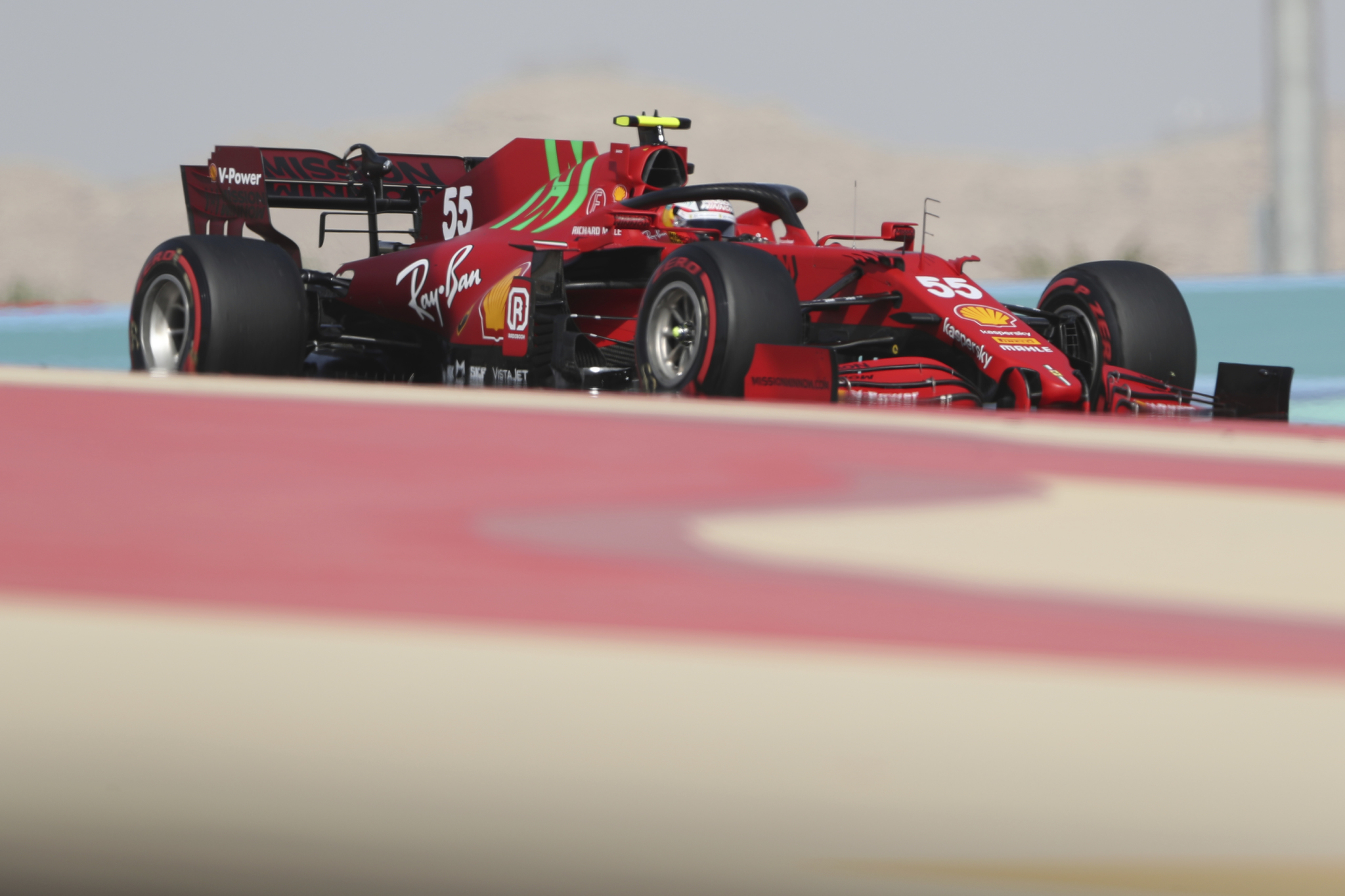 Ferrari driver lt;HIT gt;Carlos lt;/HIT gt; lt;HIT gt;Sainz lt;/HIT gt; of Spain steers his car during the first free practice at the Formula One Bahrain International Circuit in Sakhir, Bahrain, Friday, March 26, 2021. The Bahrain Formula One Grand Prix will take place on Sunday. (AP Photo/Kamran Jebreili)