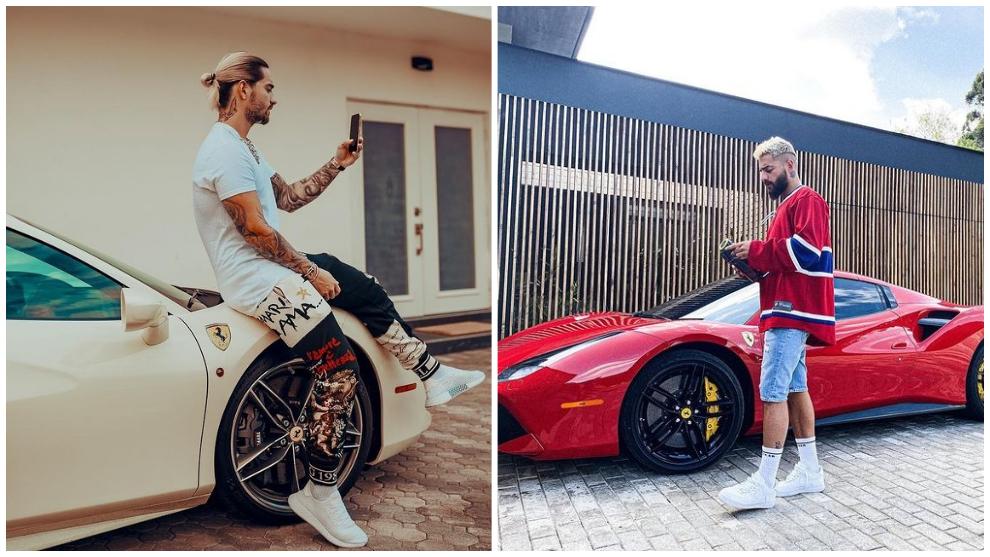 Maluma, con un Ferrari de color blanco y otro de color rojo.