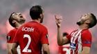 Gabi, Godín y Koke celebran una victoria.