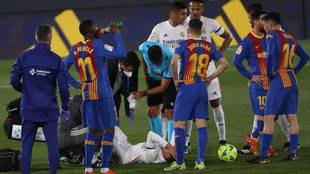 Lucas Vazquez on the ground injured after Sergio Busquets'...