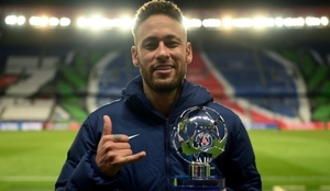 Neymar with his man-of-the-match award after PSG's match against...