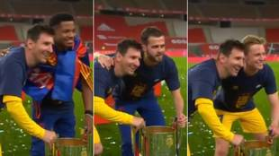 Barcelona players queue up to get a photo with Messi