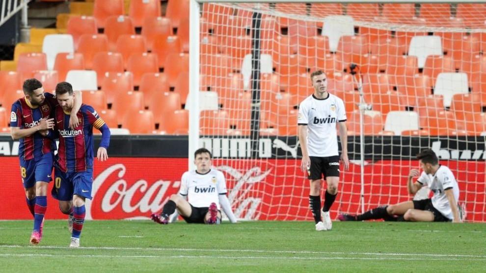 Jordi Alba and Messi celebrate at Mestalla