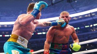 Canelo punches Saunders in the face.