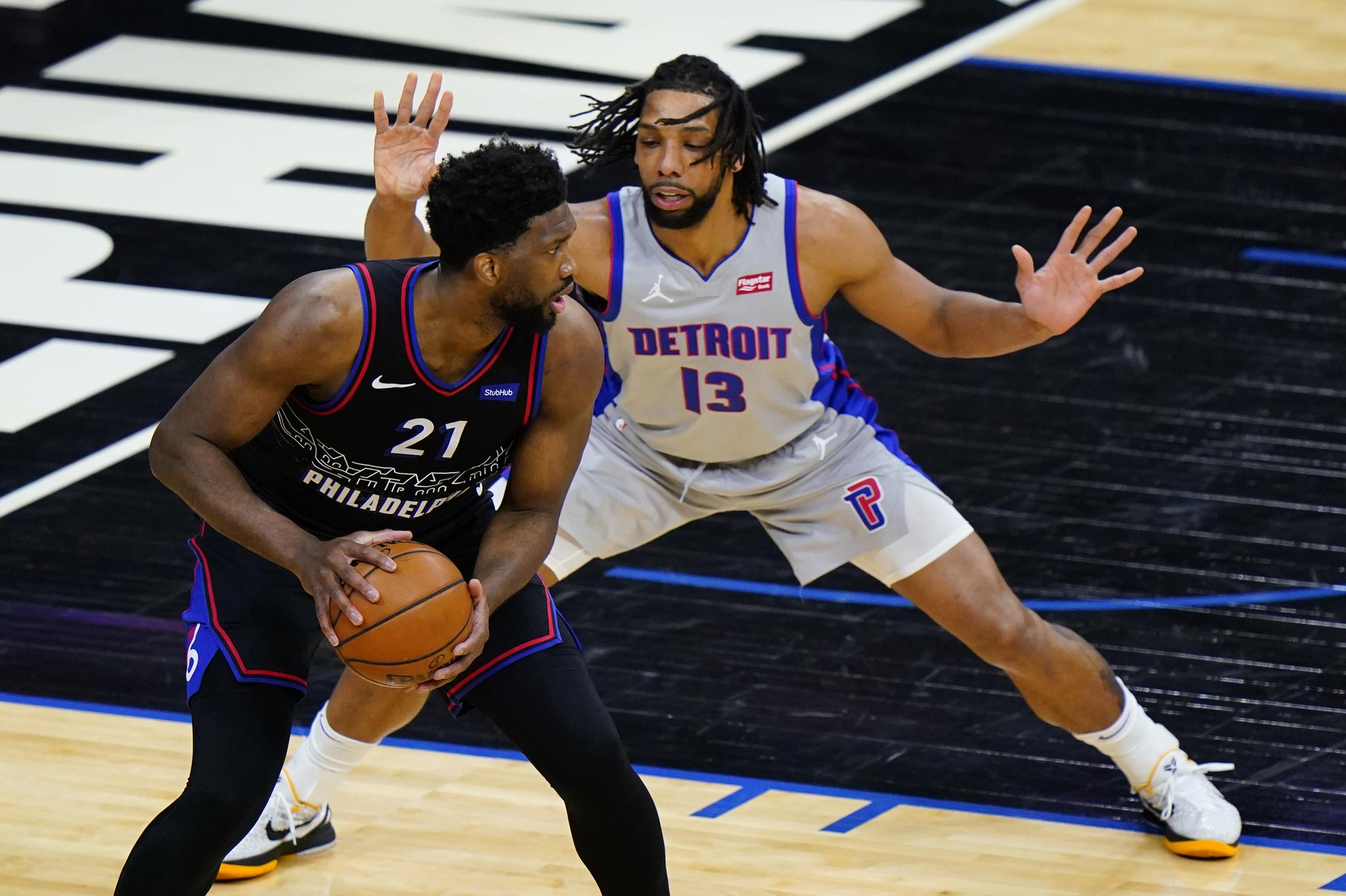 Philadelphia 76ers' Embiid tries to get around Detroit Pistons' Jahlil Okafor