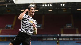 Manchester United's Edinson Cavani celebrates third goal against...
