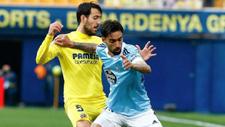 Brais Méndez defiende el balón ante la oposición de Parejo.