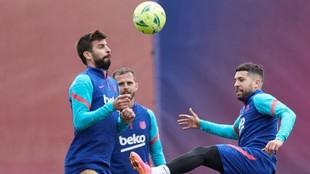 Pique, Alba and Pjanic in training.