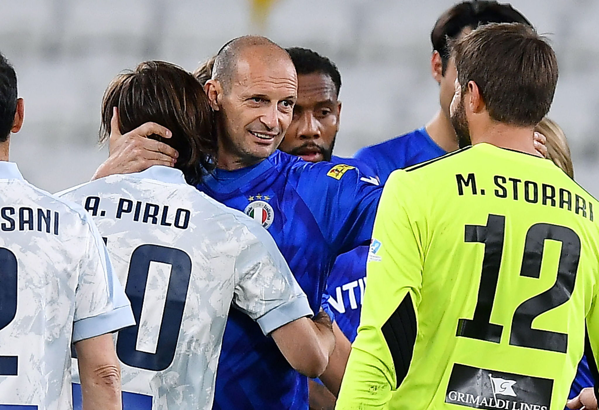 Turin (Italy), 25/05/2021.- Former Juventus' coach Massimiliano lt;HIT gt;Allegri lt;/HIT gt; (C) with Juventus' coach Andrea Pirlo and Juventus' goalkeeper Marco Storari during the 2021 'Partita del Cuore' (Match of the Heart) charity soccer match between the 'Nazionale Cantanti' (Singers national team) and 'Campioni per la Ricerca' (Research champions) at the Allianz Stadium in Turin, Italy, 25 May 2021. (Italia) EFE/EPA/ALESSANDRO DI MARCO