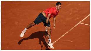 Federer serves