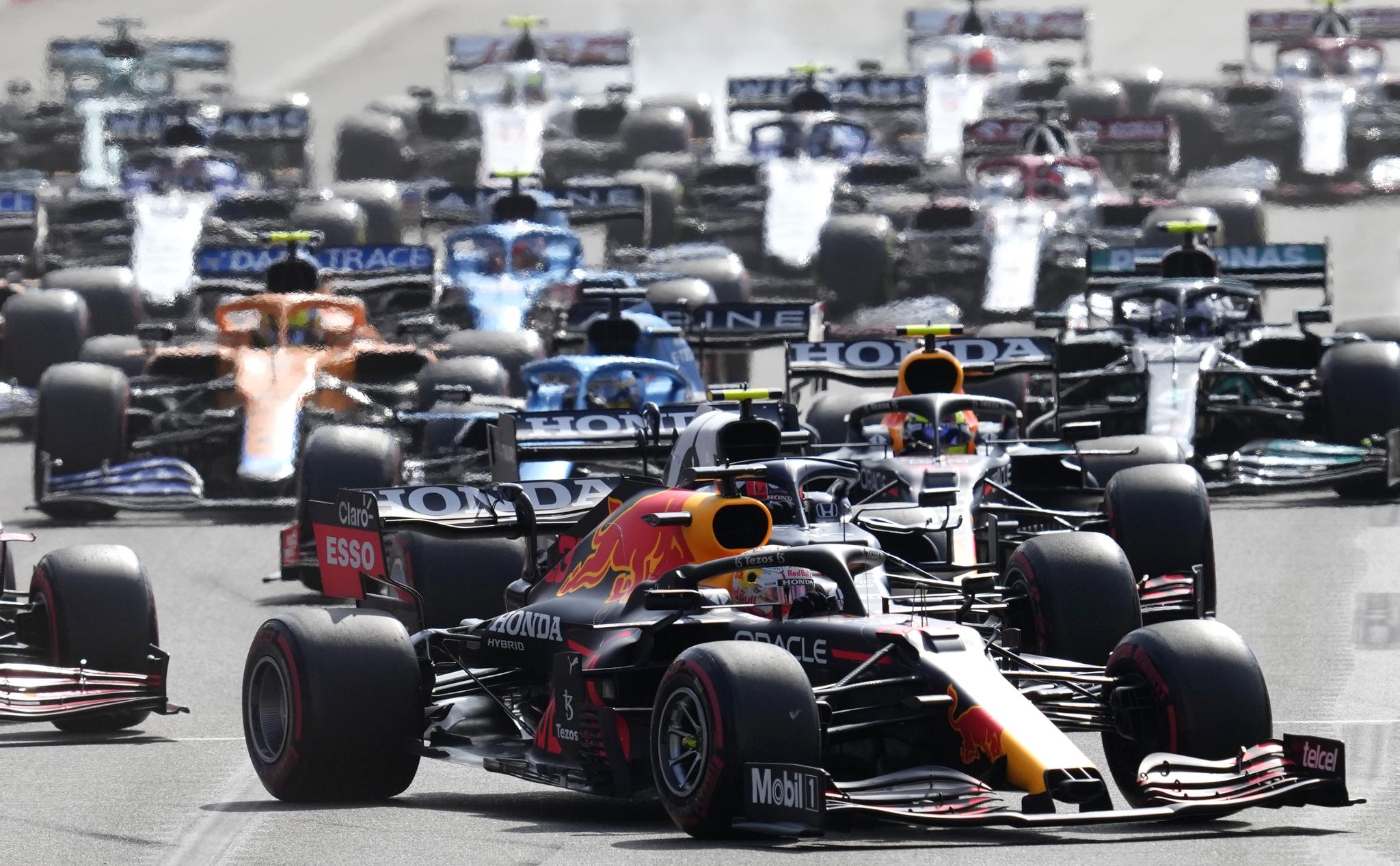 Red Bull driver Max Verstappen of the Netherlands, center, steers his car during the Formula One Grand Prix at the lt;HIT gt;Baku lt;/HIT gt; Formula One city circuit in lt;HIT gt;Baku lt;/HIT gt;, Azerbaijan, Sunday, June 6, 2021. (AP Photo/Darko Vojinovic)
