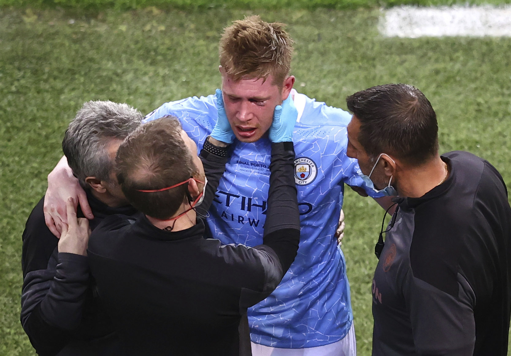 Manchester City's medical team tend to Kevin De Bruyne after a foul by Antonio Rudiger during the Champions League final.