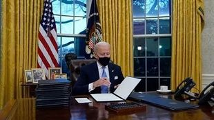 Joe Biden signs a bill